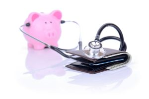 Financial planning checkup by piggy bank with stethoscope.